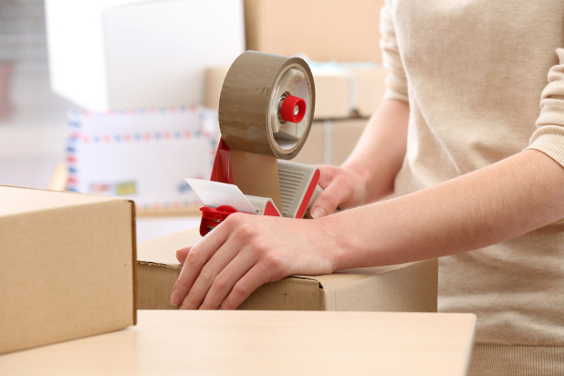 Woman packs parcel in post office